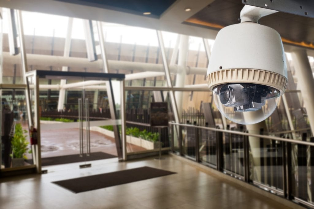 CCTV Camera operating in front of glass door